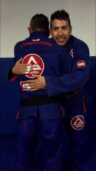 Receiving Brown Belt from my Prof, Eduardo de Lima